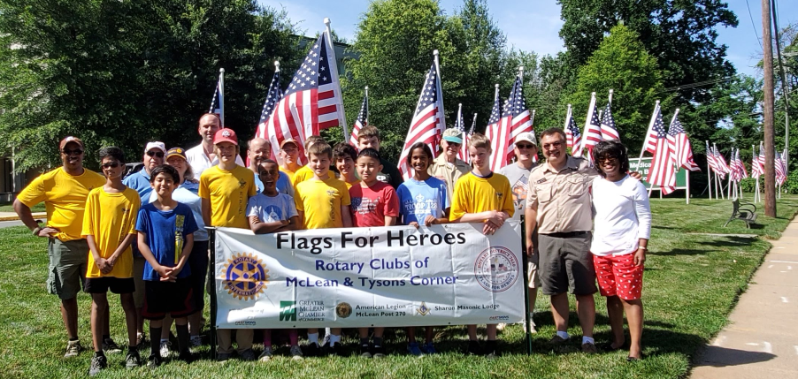 rotary club with flags for heroes